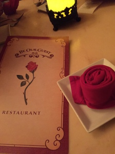 The rose-wrapped napkin and menu